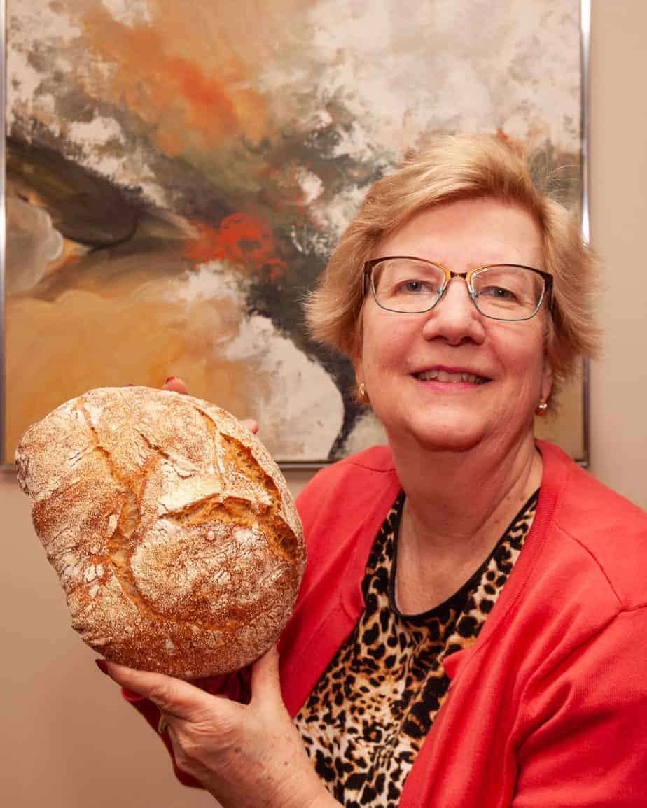 Leslie Blaize shows off her baked No-Knead Bread.