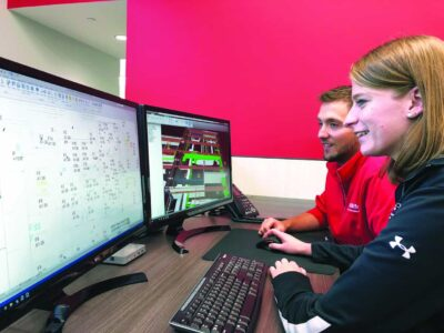 Woman - man at computer working on Building Information Modeling
