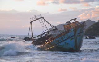 Sunken ship with cloudy sky, don't sink speech